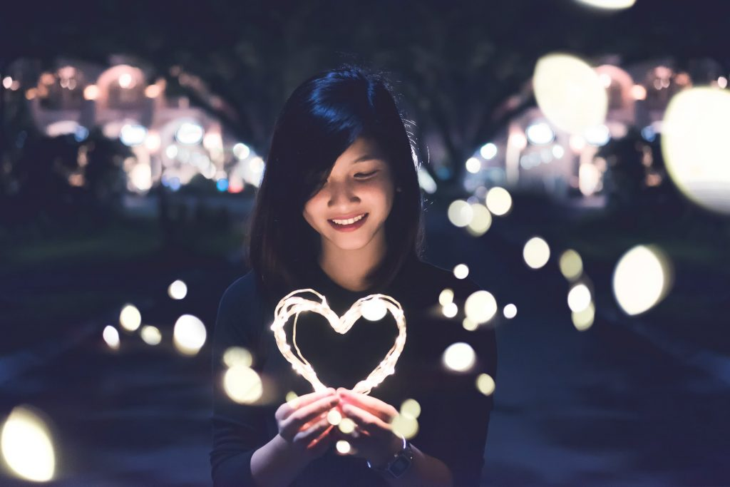 woman with light up heart