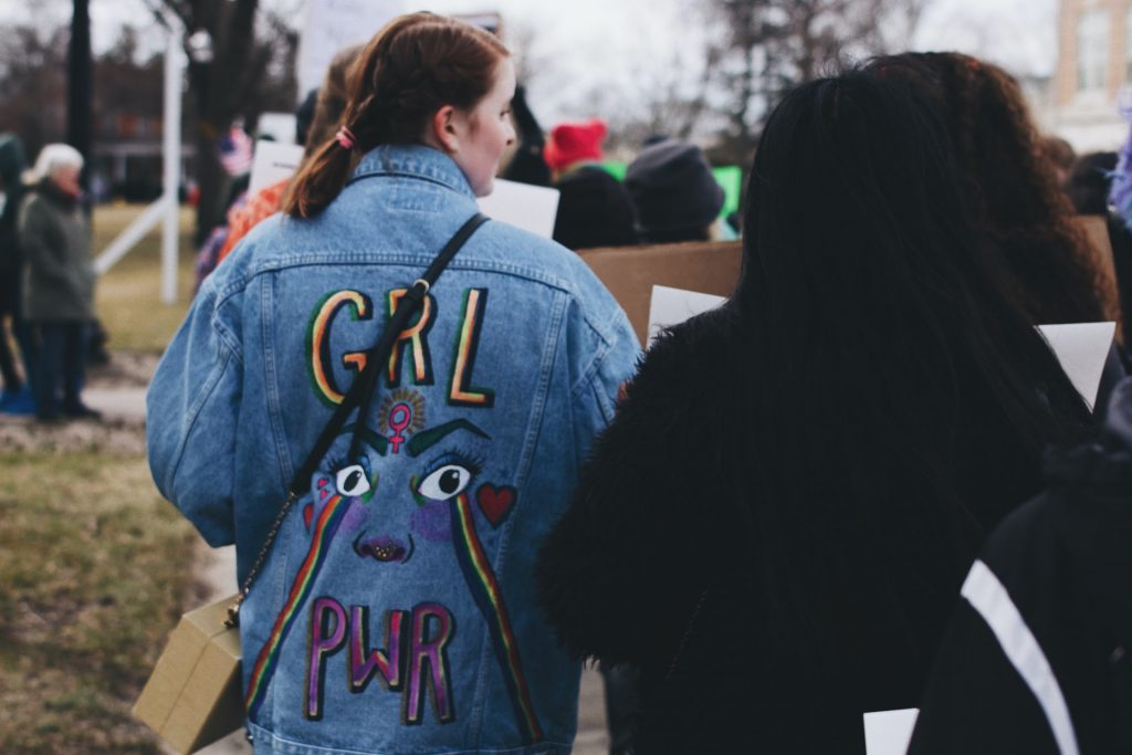 girl power jacket on woman at a protest