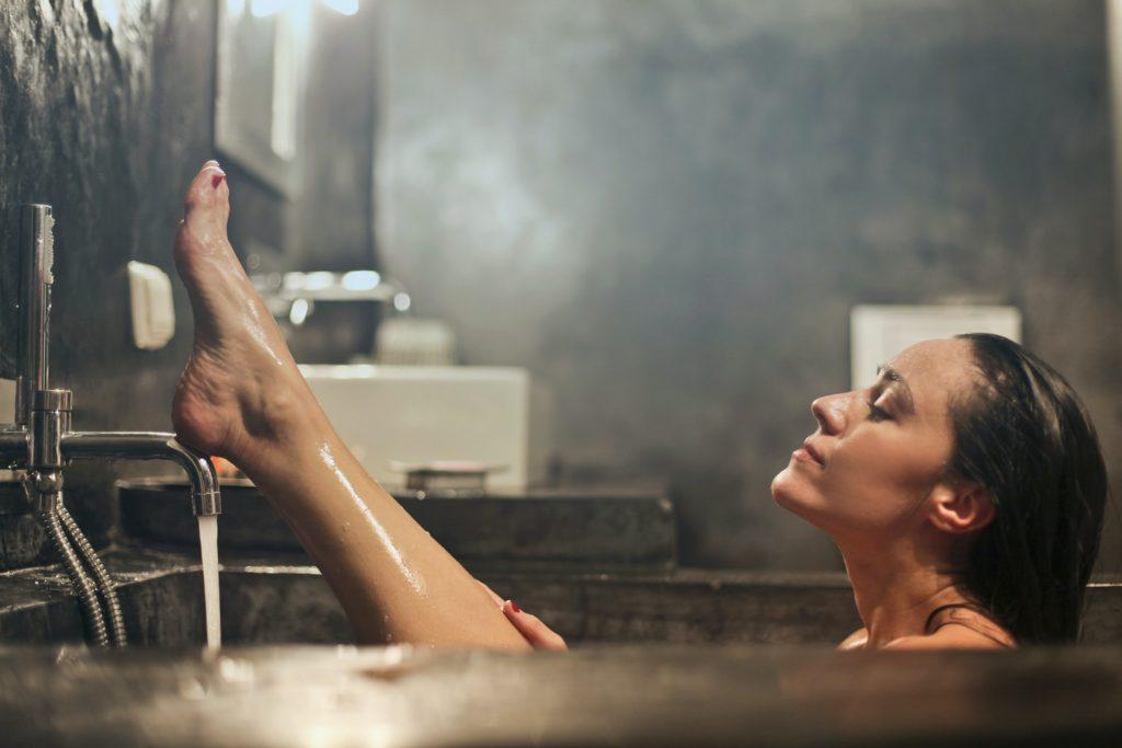 woman washing in a bath