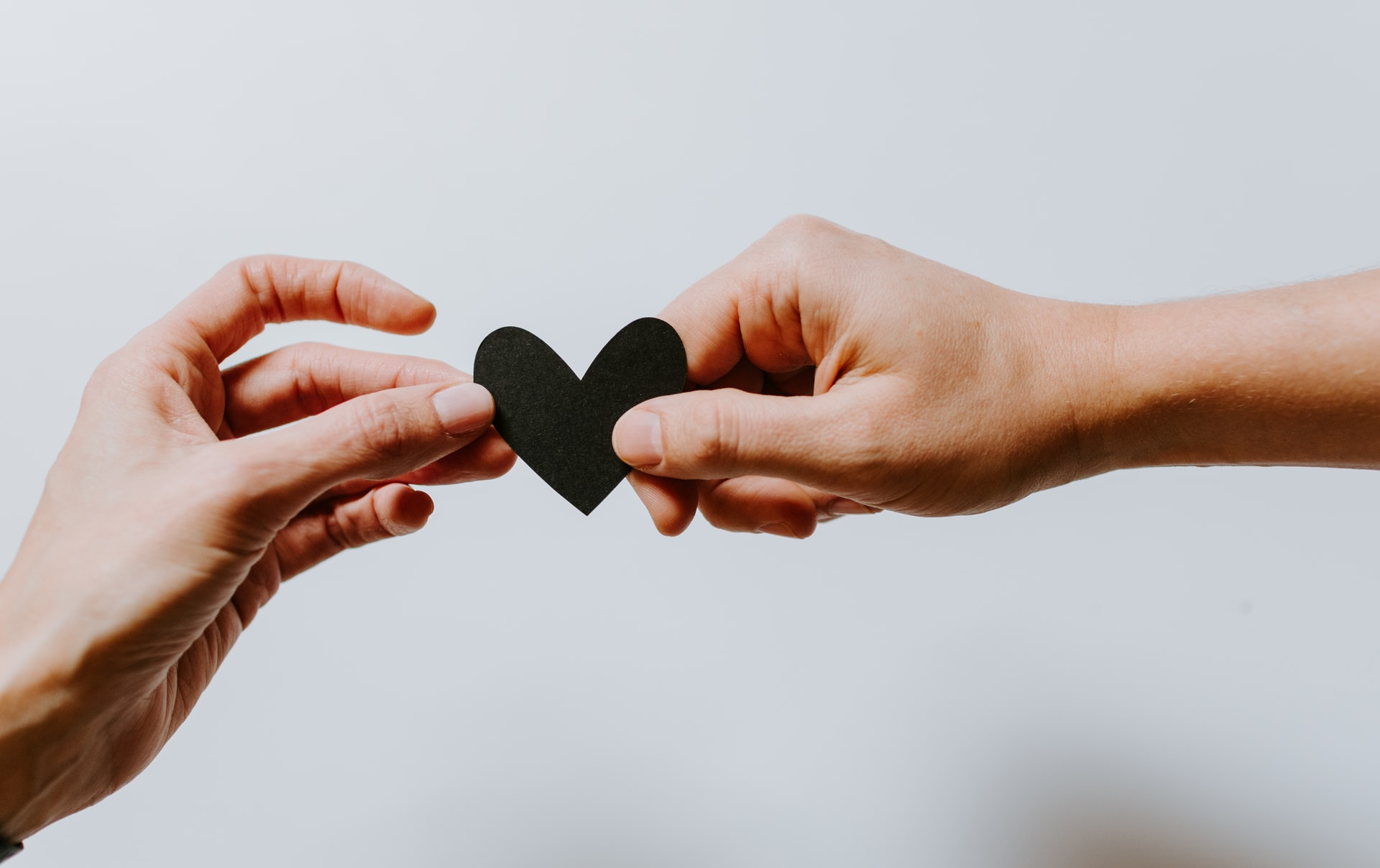 handing a heart to another person