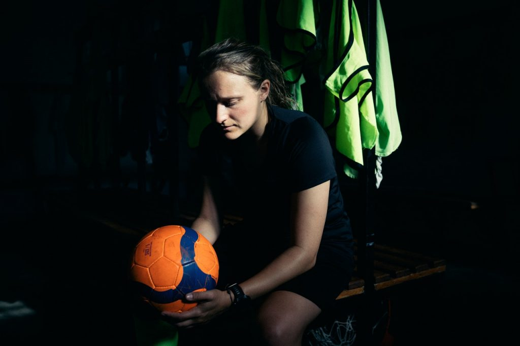 female footballer looking at ball
