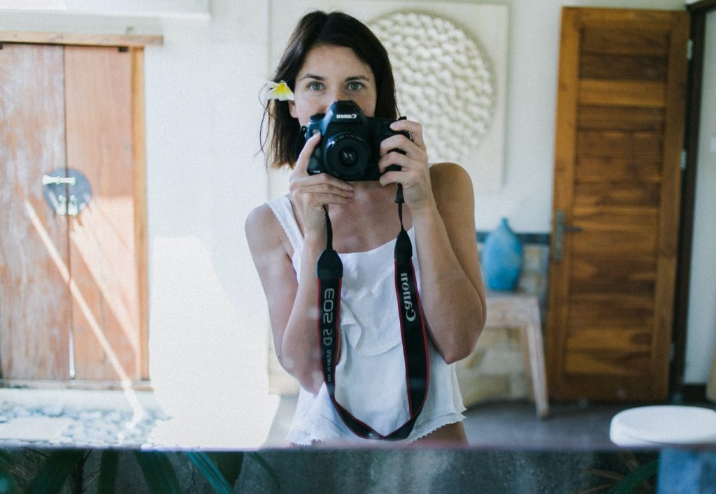woman taking photo in mirror