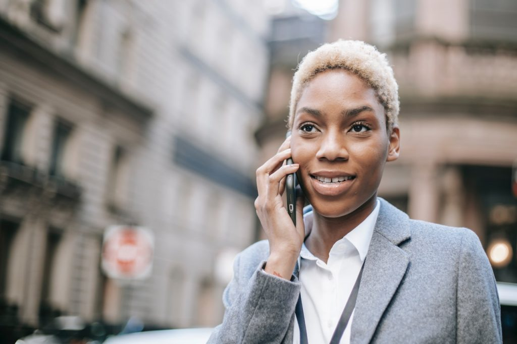 photo of a woman on the phone looking happy