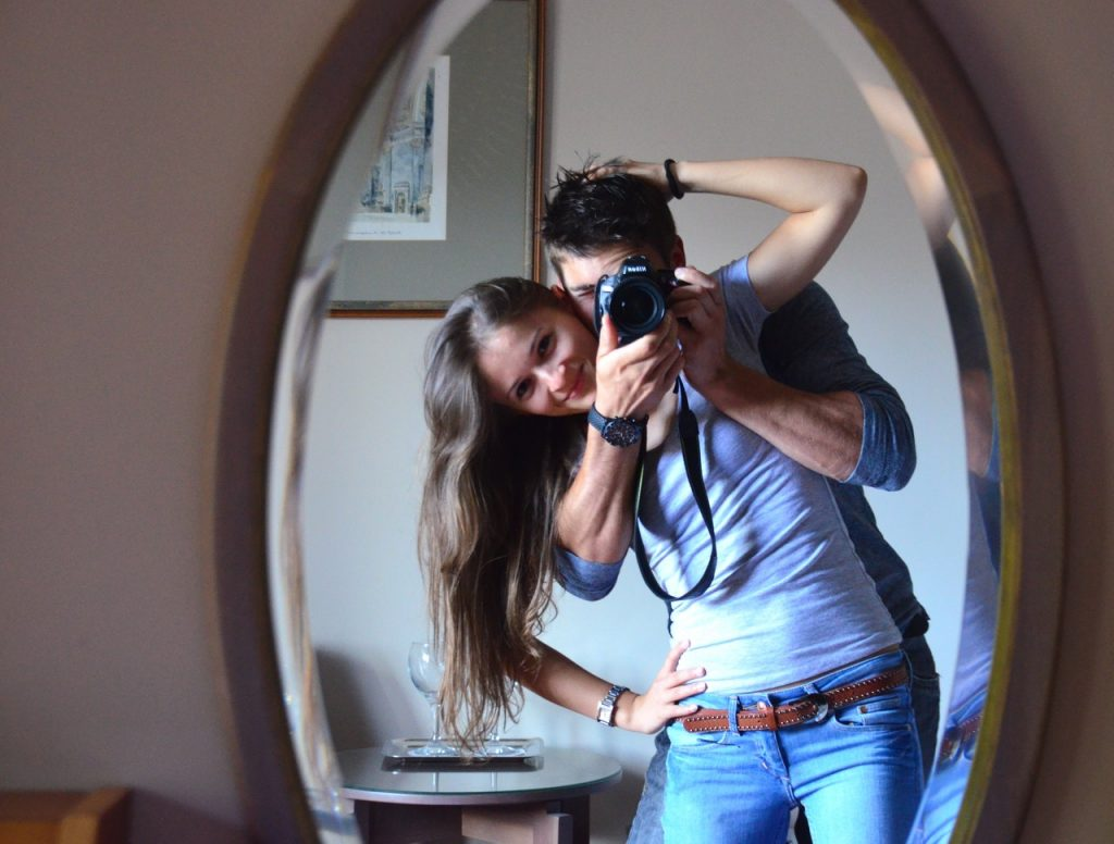 couple talking a photo together in a mirror