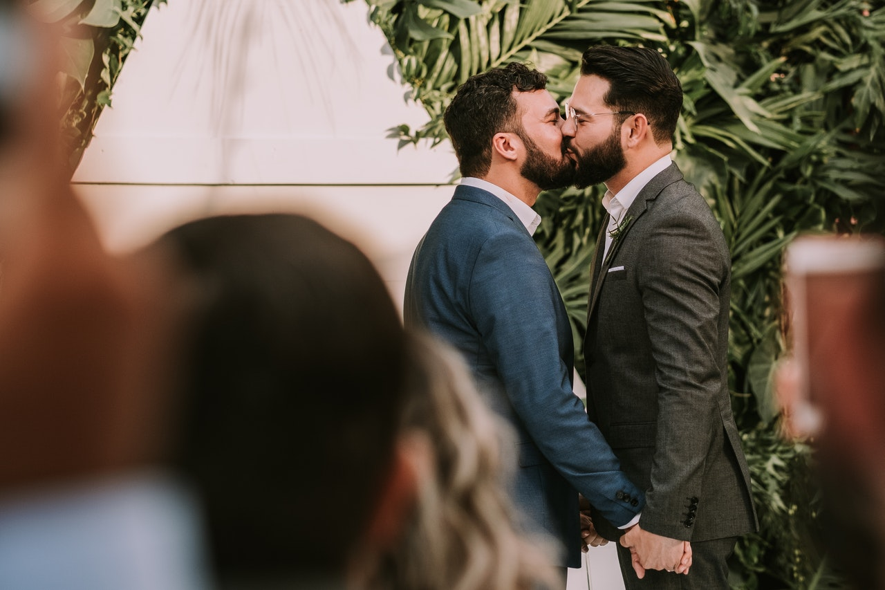 two men in a relationship who are kissing